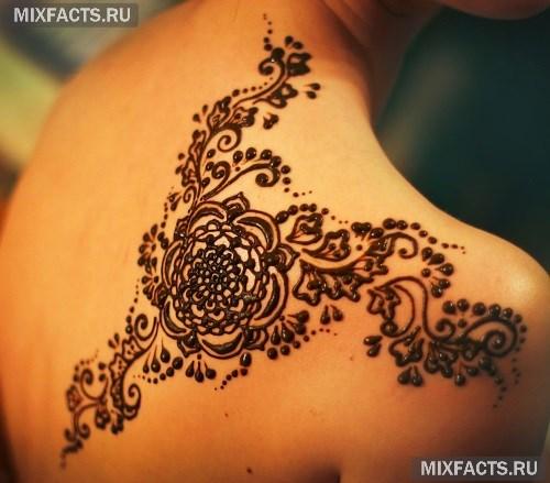 женские татуировки внизу живота фото