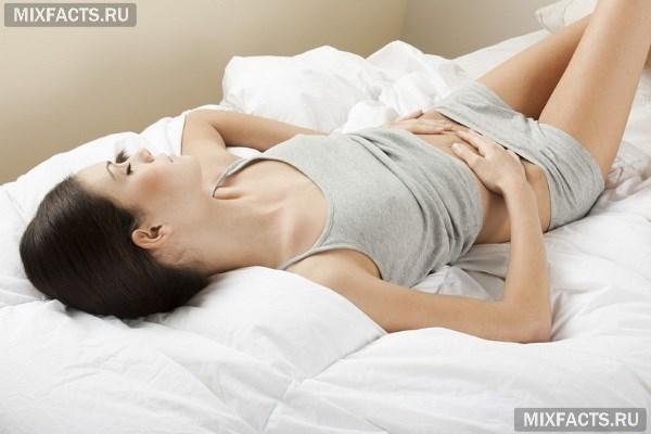 Почему месяц после родов болит живот{q}